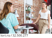 Administrator talking with client about services in nail salon. Стоковое фото, фотограф Яков Филимонов / Фотобанк Лори