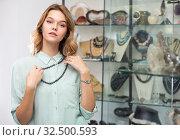 Купить «Female client trying on strand of black pearls», фото № 32500593, снято 5 декабря 2019 г. (c) Яков Филимонов / Фотобанк Лори
