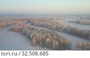 Купить «Aerial video view from drone of a Sunrise over snowy winter forest landscape. Birch forest under hoarfrost in winter season.», видеоролик № 32508685, снято 7 ноября 2019 г. (c) Serg Zastavkin / Фотобанк Лори