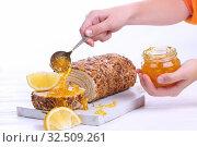 Купить «Children's hands pour jam on a piece of biscuit roll», фото № 32509261, снято 27 ноября 2019 г. (c) Марина Володько / Фотобанк Лори