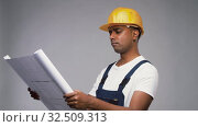 happy indian builder in helmet with blueprint. Стоковое видео, видеограф Syda Productions / Фотобанк Лори