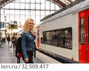 Купить «Female tourist on railway station platform, Europe», фото № 32509417, снято 10 июля 2019 г. (c) Tryapitsyn Sergiy / Фотобанк Лори