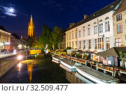Belgium, Brugge, night cityscape, church and river (2019 год). Стоковое фото, фотограф Tryapitsyn Sergiy / Фотобанк Лори