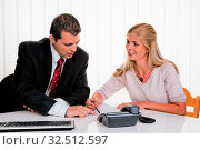 Купить «Mann und Frau bei einem Beratungsgespräch», фото № 32512597, снято 4 апреля 2020 г. (c) age Fotostock / Фотобанк Лори