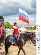 Купить «Russia, Samara, July 2019: Solemn entry of a group of horse racing with flags in the meadow of the festival.», фото № 32526113, снято 28 июля 2019 г. (c) Акиньшин Владимир / Фотобанк Лори