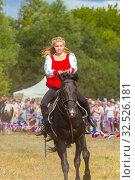 Купить «Russia, Samara, July 2018: Demonstration of a Cossack girl on a horse for guests and spectators of the festival.», фото № 32526181, снято 28 июля 2019 г. (c) Акиньшин Владимир / Фотобанк Лори