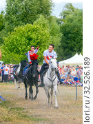 Купить «Russia, Samara, July 2019: Cossacks perform tricks on a galloping horse.», фото № 32526189, снято 28 июля 2019 г. (c) Акиньшин Владимир / Фотобанк Лори