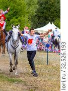 Купить «Russia, Samara, July 2019: Cossacks perform tricks on a galloping horse.», фото № 32526193, снято 28 июля 2019 г. (c) Акиньшин Владимир / Фотобанк Лори