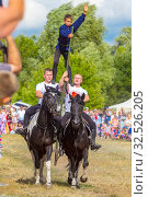 Купить «Russia, Samara, July 2019: Cossacks perform tricks on a galloping horse.», фото № 32526205, снято 28 июля 2019 г. (c) Акиньшин Владимир / Фотобанк Лори