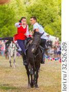 Купить «Russia, Samara, July 2019: Cossacks perform tricks on a galloping horse.», фото № 32526209, снято 28 июля 2019 г. (c) Акиньшин Владимир / Фотобанк Лори