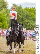 Купить «Russia, Samara, July 2019: Cossacks perform tricks on a galloping horse.», фото № 32526213, снято 28 июля 2019 г. (c) Акиньшин Владимир / Фотобанк Лори