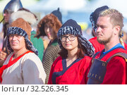 Купить «Russia, Samara, July 2019: an ethno-historical holiday with a reconstruction of the battle of Timur and Tokhtamysh in 1391. The participants of the festival.», фото № 32526345, снято 28 июля 2019 г. (c) Акиньшин Владимир / Фотобанк Лори