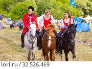 Купить «Russia, Samara, July 2019: Cossacks perform tricks on a galloping horse.», фото № 32526469, снято 28 июля 2019 г. (c) Акиньшин Владимир / Фотобанк Лори