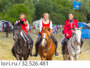 Купить «Russia, Samara, July 2019: Cossacks perform tricks on a galloping horse.», фото № 32526481, снято 28 июля 2019 г. (c) Акиньшин Владимир / Фотобанк Лори