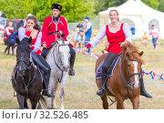 Купить «Russia, Samara, July 2019: Cossacks perform tricks on a galloping horse.», фото № 32526485, снято 28 июля 2019 г. (c) Акиньшин Владимир / Фотобанк Лори