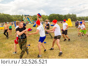 Купить «Russia, Samara, July 2019: an ethno-historical holiday with a reconstruction of the battle of Timur and Tokhtamysh in 1391. Battle of Stenos. Competition of men from wall to wall. Fist fights.», фото № 32526521, снято 28 июля 2019 г. (c) Акиньшин Владимир / Фотобанк Лори