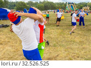 Купить «Russia, Samara, July 2019: an ethno-historical holiday with a reconstruction of the battle of Timur and Tokhtamysh in 1391. Battle of Stenos. Competition of men from wall to wall. Fist fights.», фото № 32526525, снято 28 июля 2019 г. (c) Акиньшин Владимир / Фотобанк Лори