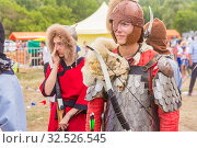 Купить «Russia, Samara, July 2019: an ethno-historical holiday with a reconstruction of the battle of Timur and Tokhtamysh in 1391. The participants of the festival.», фото № 32526545, снято 28 июля 2019 г. (c) Акиньшин Владимир / Фотобанк Лори