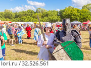 Купить «Russia, Samara, July 2019: an ethno-historical holiday with a reconstruction of the battle of Timur and Tokhtamysh in 1391. Joint photo with the participant of the festival. Warrior in the armor.», фото № 32526561, снято 28 июля 2019 г. (c) Акиньшин Владимир / Фотобанк Лори