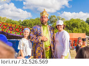 Купить «Russia, Samara, July 2019: an ethno-historical holiday with a reconstruction of the battle of Timur and Tokhtamysh in 1391. Joint photo with the festival khan participant.», фото № 32526569, снято 28 июля 2019 г. (c) Акиньшин Владимир / Фотобанк Лори