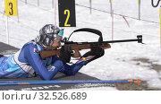 Sportswoman biathlete aiming, rifle shooting prone position. Biathlete Arina Soldatova in shooting range. Regional junior biathlon competitions East Cup (2019 год). Редакционное видео, видеограф А. А. Пирагис / Фотобанк Лори