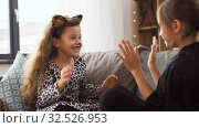 girls in halloween costumes playing game at home. Стоковое видео, видеограф Syda Productions / Фотобанк Лори