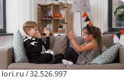 Купить «kids in halloween costumes playing game at home», видеоролик № 32526997, снято 14 ноября 2019 г. (c) Syda Productions / Фотобанк Лори