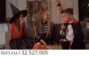 Купить «kids in halloween costumes playing at home», видеоролик № 32527005, снято 14 ноября 2019 г. (c) Syda Productions / Фотобанк Лори