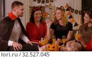 Купить «happy friends in halloween costumes at home party», видеоролик № 32527045, снято 18 ноября 2019 г. (c) Syda Productions / Фотобанк Лори