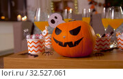Купить «halloween decorations and treats on table at home», видеоролик № 32527061, снято 18 ноября 2019 г. (c) Syda Productions / Фотобанк Лори