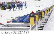 Купить «Group of sportsman biathlete aiming, rifle shooting and reloading rifle in prone position. Junior biathlon competitions East of Cup», видеоролик № 32527197, снято 13 апреля 2019 г. (c) А. А. Пирагис / Фотобанк Лори