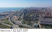 Aerial view of new residential complex of Diagonal Mar i el Front Maritim del Poblenou on sunny fall day, Barcelona, Spain. Стоковое видео, видеограф Яков Филимонов / Фотобанк Лори