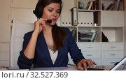 Купить «Smiling young female operator talking with customer using headset at company office», видеоролик № 32527369, снято 4 июня 2019 г. (c) Яков Филимонов / Фотобанк Лори