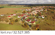 Купить «General aerial view of Czech village of Ostrov u Macochy on sunny autumn day, South Moravian Region», видеоролик № 32527385, снято 16 октября 2019 г. (c) Яков Филимонов / Фотобанк Лори