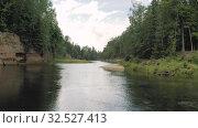 Купить «River banks in Europe, Gaujas Latvia National Park 4K Drone shot», видеоролик № 32527413, снято 11 сентября 2019 г. (c) Aleksejs Bergmanis / Фотобанк Лори