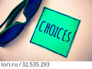 Купить «Word writing text Choices. Business concept for Preference Discretion Inclination Distinguish Options Selection Green paper beige background sunglasses ideas messages feelings thoughts», фото № 32535293, снято 25 мая 2020 г. (c) easy Fotostock / Фотобанк Лори