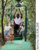 Купить «Trolls or Zip Line - this is speed descent along rope or rope stretched at an angle», фото № 32536269, снято 7 декабря 2019 г. (c) Яков Филимонов / Фотобанк Лори