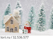 Купить «Snowman and house in winter», фото № 32536577, снято 22 ноября 2019 г. (c) Иван Михайлов / Фотобанк Лори