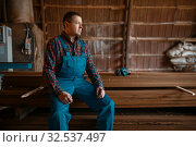 Joiner in uniform at his workplace on timber mill. Стоковое фото, фотограф Tryapitsyn Sergiy / Фотобанк Лори
