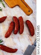 Купить «Sliced half-smoked sausages susena on wooden table. Traditional Chezh meat products», фото № 32538685, снято 29 февраля 2020 г. (c) Яков Филимонов / Фотобанк Лори