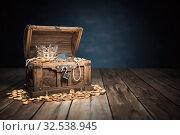 Купить «Open treasure chest filled with golden coins, gold and jewelry.», фото № 32538945, снято 26 мая 2020 г. (c) Maksym Yemelyanov / Фотобанк Лори