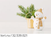 little ceramic snowman with fir on white background. Стоковое фото, фотограф Майя Крученкова / Фотобанк Лори
