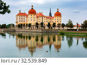 MORITZBURG, GERMANY - AUGUST 21: Moritzburg castle in Moritzburg, Germnay on August 21, 2018. The Baroque castle was built in the 16th century by Duke Moritz of Saxony. Стоковое фото, фотограф Zoonar.com/manfredxy / age Fotostock / Фотобанк Лори