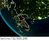 Купить «Satellite view of Laos highlighted in red on planet Earth at night with borderlines and city lights. 3D illustration. Elements of this image furnished by NASA.», фото № 32550245, снято 8 декабря 2019 г. (c) easy Fotostock / Фотобанк Лори