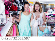 Female customers in underwear shop. Стоковое фото, фотограф Яков Филимонов / Фотобанк Лори