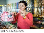 Купить «girl buying candies at shop», фото № 32553645, снято 22 марта 2017 г. (c) Яков Филимонов / Фотобанк Лори