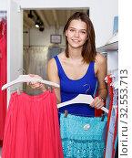 Купить «Woman shopping in clothing boutique», фото № 32553713, снято 17 сентября 2018 г. (c) Яков Филимонов / Фотобанк Лори