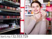 Купить «female customer looking for lipstick in cosmetics shop», фото № 32553729, снято 21 февраля 2017 г. (c) Яков Филимонов / Фотобанк Лори