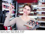 Купить «Young female client is searching for reliable blushes», фото № 32553737, снято 21 февраля 2017 г. (c) Яков Филимонов / Фотобанк Лори