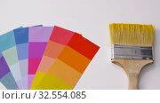 Купить «paint brush and color palette on white background», видеоролик № 32554085, снято 28 ноября 2019 г. (c) Syda Productions / Фотобанк Лори